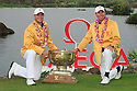 Gary Woodland and Matt Kuchar of USA pose with the trophy after the final round of the Omega Mission Hills World Cup played at The Blackstone Course, Mission Hills Golf Club on November 27th in Haikou, Hainan Island, China.( Picture Credit / Phil Inglis )