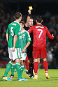 Portugal's Christiano Ronaldo gets a yellow card after Portugal's  Helder Postiga head butt's Northern Ireland's  McAuley during the first half a World Cup Qualifier in Belfast, Friday September 6th, 2013.  Photo/Paul McErlane