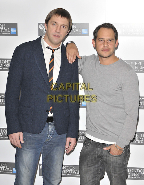 """Vladimir Vdovichenkov & Moritz Bleibtreu.The """"360"""" press conference & photocall, 55th BFI LFF Day 1, Vue West End cinema, Leicester Square, London, England..October 12th, 2011.half length black suit jacket white shirt grey gray top hand on shoulder.CAP/CAN.©Can Nguyen/Capital Pictures."""