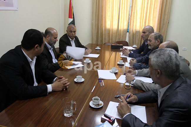 Members of the Freedoms Committee, which includes Fatah, Hamas and others Palestinian movements, meet to follow up the implementation of the reconciliation steps, in Gaza City, on April 30, 2014. Israeli cabinet ministers differed over the likely fallout on the battered Middle East peace process from an intra-Palestinian reconciliation agreement which saw Palestinian leaders from the West Bank and the Hamas-run Gaza Strip agree to work together after years of bitter rivalry. Photo by Mohammed Asad