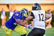 Newark, DE - OCT 29, 2016: Towson Tigers quarterback Triston Harris (12) is sacked for a big loss by Delaware Fightin Blue Hens linebacker Jasawn Thompson (29) during game between Towson and Delaware at Delaware Stadium Tubby Raymond Field in Newark, DE. (Photo by Phil Peters/Media Images International)