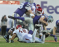 NWA Democrat-Gazette/MICHAEL WOODS • @NWAMICHAELW<br /> University of Arkansas defender Arkansas defensive lineman DeMarcus Hodge (93)tackles Kansas State quarterback Kody Cook in the 3rd quarter of the Razorbacks 45-23 win over Kansas State in the 57th annual AutoZone Liberty Bowl January 2, 2016.