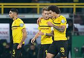 February 5th 2019, Dortmund, Germany, German DFB Cup round of 16, Borussia Dortmund versus SV Werder Bremen;  Dortmund's Marco Reus (M) talks to Achraf Hakimi (l) and Axel Witsel after scoring for 1-1.
