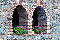 Begonias in window opening. Castello di Amerorosa. Napa Valley, California. Property relased