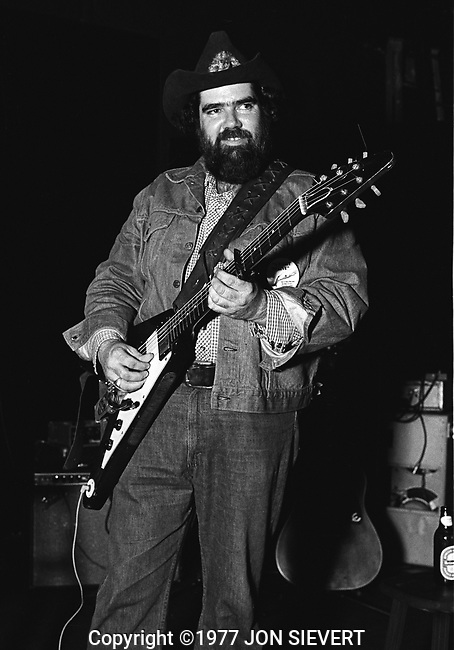 """Lonnie Mack, April 18, 1977, Boarding House, San Francisco. American blues singer and guitarist. He was born in Dubuisson, Louisiana. Rolling Stone says, """"His music is witty, soulful and ferociously energetic, brimming with novel harmonic turnarounds, committed vocals and simply astonishing guitar work.""""[2] ''The New York Times'' adds, """"He sings in a rowdy baritone, sliding and rasping in songs that celebrate lust, fulfilled and unfulfilled; his guitar solos are pointed and unhurried, with a tone that slices cleanly across the beat. Wearing a cowboy hat, he looks like the embodiment of a good-time bluesman."""