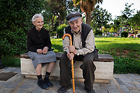 Albania. Berat, An elderly couple sit on a bench and enjoys a time together at the end of the afternoon. Berat, historically known as Poulcheriopólis and Antipatreia, is the ninth most populous city of the Republic of Albania. The city is the capital of the surrounding Berat County. 26.05.2018 © 2018 Didier Ruef