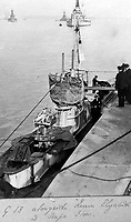 BNPS.co.uk (01202 558833)<br /> Pic Lawrences/BNPS<br /> <br /> Submarine G 13 alongside HMS Queen Elizabeth in Scapa Flow during WW1.<br /> <br /> Fascinating early photos of submarine warfare featuring close quarters views of German battleships have come to light 100 years later.<br /> <br /> The photo albums were collated by British Commander Maurice Bailward who documented every stage of his naval career.<br /> <br /> Cmdr Bailward attended Royal Naval College in Osborne, Isle of Wight, from 1906 and 1908, the same time as Edward, the Prince of Wales.<br /> <br /> He was involved in many of the major sea battles of World War Two as well as the British effort to help the Whites during the Russian Civil War of 1919.<br /> <br /> The albums have emerged for sale at auction from a family descendant with Lawrences Auctioneers, of Crewkerne, Somerset.