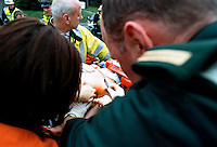 RTA the driver has been loaded onto a stretcher the doctor has made an incision through the wall of the victims chest and is now preparing to insert a chest drain because they believe that he is bleeding internally into his lung. This image may only be used to portray the subject in a positive manner..©shoutpictures.com..john@shoutpictures.com