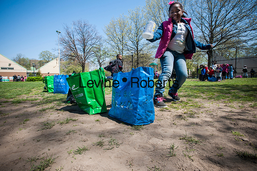 First and second graders from neighborhood schools celebrate Arbor Day playing recycling relay games in Herbert Von King Park in the Bedford-Stuyvesant neighborhood of Brooklyn in New York on Friday, April 26, 2013. The students planted trees, painted murals, and learned about the importance of trees in keeping the air we breathe clean. (© Richard B. Levine)