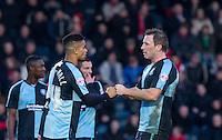 Substitute Paris Cowan-Hall of Wycombe Wanderers punches fists with Garry Thompson of Wycombe Wanderers during the Sky Bet League 2 match between Wycombe Wanderers and Leyton Orient at Adams Park, High Wycombe, England on 23 January 2016. Photo by Andy Rowland / PRiME Media Images.