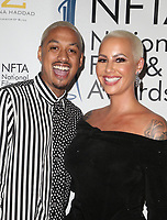 LOS ANGELES, CA - DECEMBER 5: Alexander Edwards, Amber Rose, at The National Film and Television Awards at The Globe Theater in Los Angeles, California on December 5, 2018. Credit: Faye Sadou/MediaPunch