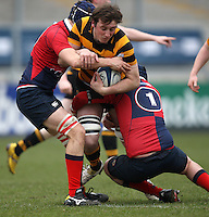 4 March 2013; RBAI number 8 Patrick Anderson is tackled by Ballyclare second row David Allen and prop David Lawther during the schools cup semi-final clash between RBAI and Ballyclare High School at Ravenhill Belfast. Photo Credit : John Dickson / DICKSONDIGITAL