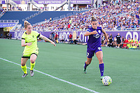 Orlando, Florida - Sunday, May 8, 2016: Orlando Pride defender Stephanie Catley (7) takes on Seattle Reign FC midfielder Kim Little (8) during a National Women's Soccer League match between Orlando Pride and Seattle Reign FC at Camping World Stadium.