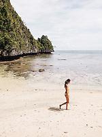 Kenes Andari, an Indonesian model, at an unnamed beach of Farondi, Misool, Raja Ampat, Indonesia