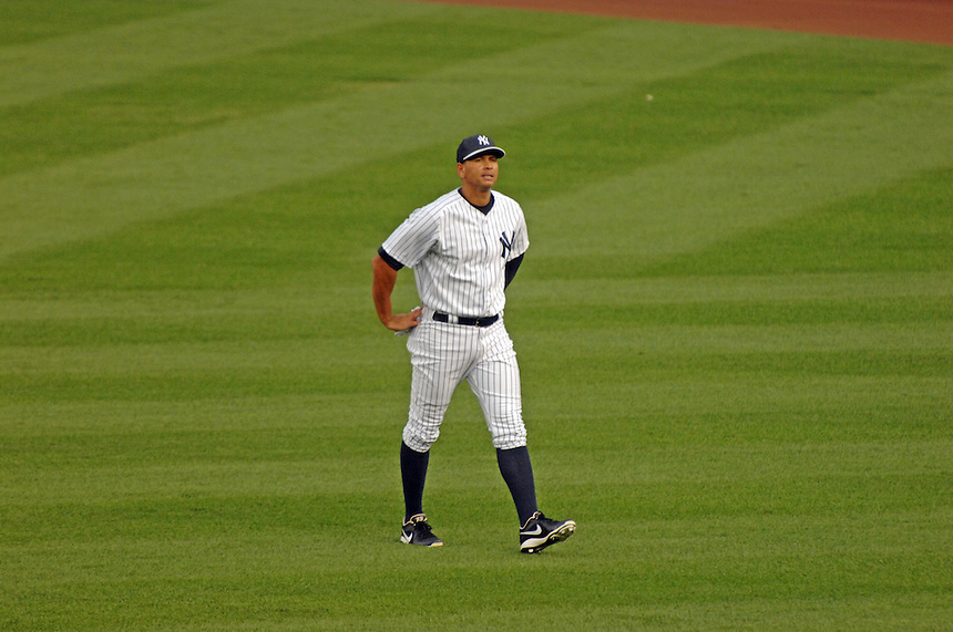 Alex Rodriguez takes the field at Yankee Stadium for the first time in 2013 following hip surgery and the announcement of his 211 game suspension. MARK TAYLOR GALLERY.