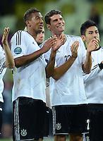 FUSSBALL  EUROPAMEISTERSCHAFT 2012   VIERTELFINALE Deutschland - Griechenland     22.06.2012 Deutscher Jubel nach dem Abpfiff: Jerome Boateng und Mario Gomez (v.l., beide Deutschland)