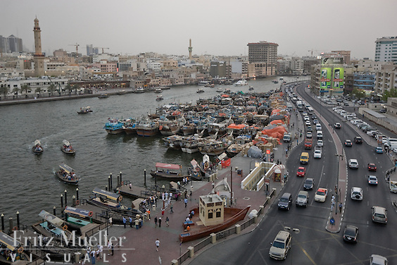 Historic Dubai and Dubai Creek, busy with tours, passenger ferries and cargo ships bound for Iran
