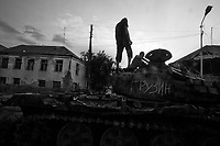 Tshinvali, South Ossetia, August 21, 2008.Life is slowly returning to normal, .Children play on a destroyed Georgian tank.