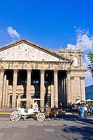 A calandria (horse drawn carriage) in front of Teatro Degollado in the Historic Center of Guadalajara, Jalisco, Mexico