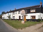 Cottages and village sign at Lessingham, Norfolk, England