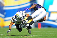 Sep. 20, 2009; San Diego, CA, USA; Baltimore Ravens wide receiver Kelley Washington gets tackled by San Diego Chargers safety (28) Steve Gregory at Qualcomm Stadium in San Diego. Baltimore defeated San Diego 31-26. Mandatory Credit: Mark J. Rebilas-