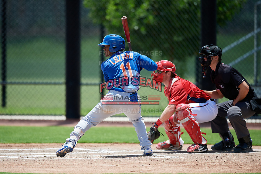 GCL Mets second baseman David Lozano (11) at bat in front of catcher Joey Harris (4) and home plate umpire Ryne Sigmon during a game against the GCL Nationals on August 4, 2018 at FITTEAM Ballpark of the Palm Beaches in West Palm Beach, Florida.  GCL Nationals defeated GCL Mets 7-4.  (Mike Janes/Four Seam Images)