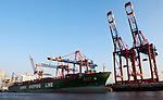 Hamburg-Germany - May 04, 2013 -- Port of Hamburg / harbour at the river Elbe: container cranes at Waltershofer Hafen (HHLA, Hamburger Hafen und Logistik Aktiengesellschaft), with a container cargo ship run by the China Shipping Line, Infrastructure -- Photo: © HorstWagner.eu