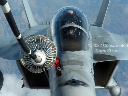 Afghanistan - December 7, 2009 -- An F/A-18F Super Hornet assigned to the Black Aces of Strike Fighter Squadron (VFA) 41 refuels Monday, December 7, 2009 from an Air Force KC-10 Extender tanker aircraft. VFA-41 is embarked aboard the aircraft carrier USS Nimitz (CVN 68) deployed to the U.S. 5th Fleet area of responsibility supporting Operation Enduring Freedom. .Mandatory Credit: Kyle Terwilliger - U.S. Navy via CNP.