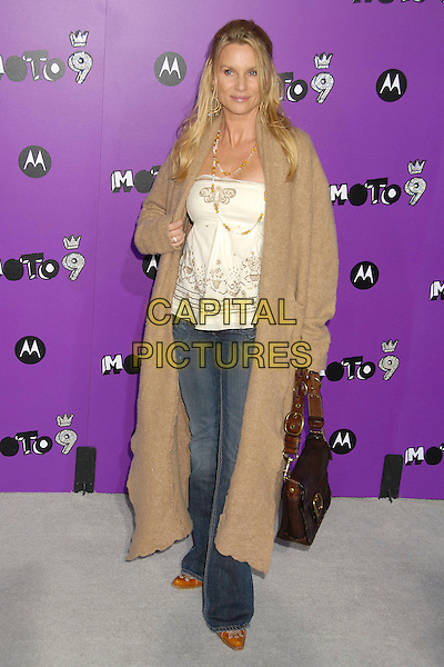 NICOLLETTE SHERIDAN.9th Annual Motorola in Hollywood Party at The Lot, West Hollywood, California, USA, 8 November 2007..Nicolette full length jeans white top brown tan coat long cardiagan.CAP/ADM/BP .©Byron Purvis/AdMedia/Capital Pictures.