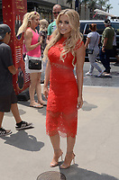 HOLLYWOOD, CA - JULY 12: Carmen Electra<br /> wearing a red dress spotted at Hollywood &amp; Highland in Hollywood, California on July 12, 2017. Credit: David Edwards/MediaPunch