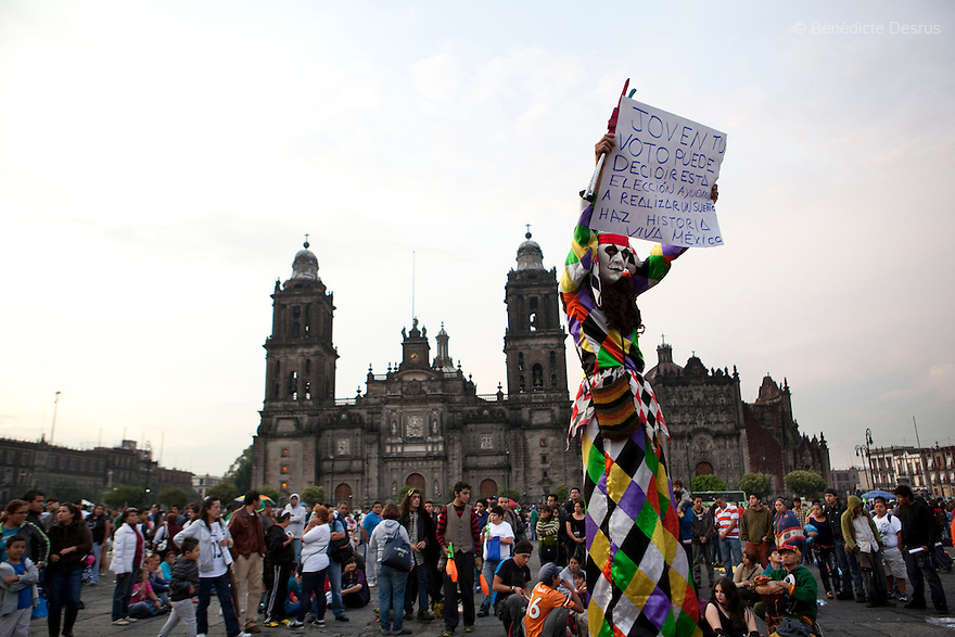 """30 June 2012 - Mexico City, Mexico - Demonstrators and university students members of the movement ?yo soy 132? (I am 132) during a demonstration to demand transparency in the next election at Zocalo square in Mexico City. """"YoSoy132"""" movement was organized by students against the candidature of Enrique Pena Nieto, presidential candidate of the opposition Institutional Revolutionary Party (PRI), who also demanded a balance in the media coverage of the presidential race. Mexico's presidential elections will take place on July 1. Photo credit: Benedicte Desrus"""
