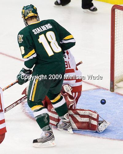 Viktor Stalberg (Vermont - 18), Kieran Millan (BU - 31) - The Boston University Terriers defeated the University of Vermont Catamounts 5-4 on Thursday, April 9, 2009, in the 2009 Frozen Four Semi-Final at the Verizon Center in Washington, DC.