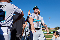 Salt River Rafters pitcher Shane Baz (35), of the Tampa Bay Rays organization, celebrates with coach Luis Ramirez (19) after winning the Arizona Fall League Championship Game against the Surprise Saguaros on October 26, 2019 at Salt River Fields at Talking Stick in Scottsdale, Arizona. The Rafters defeated the Saguaros 5-1. (Zachary Lucy/Four Seam Images)
