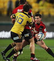 Aaron Cruden's path to Ryan Crotty is blocked by Corey Flynn. Super 15 rugby match - Crusaders v Hurricanes at Westpac Stadium, Wellington, New Zealand on Saturday, 18 June 2011. Photo: Dave Lintott / lintottphoto.co.nz