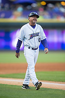 Winston-Salem Dash manager Tim Esmay (10) walks towards home plate to discuss a call during the game against the Potomac Nationals at BB&T Ballpark on April 30, 2015 in Winston-Salem, North Carolina.  The Nationals defeated the Dash 5-4..  (Brian Westerholt/Four Seam Images)
