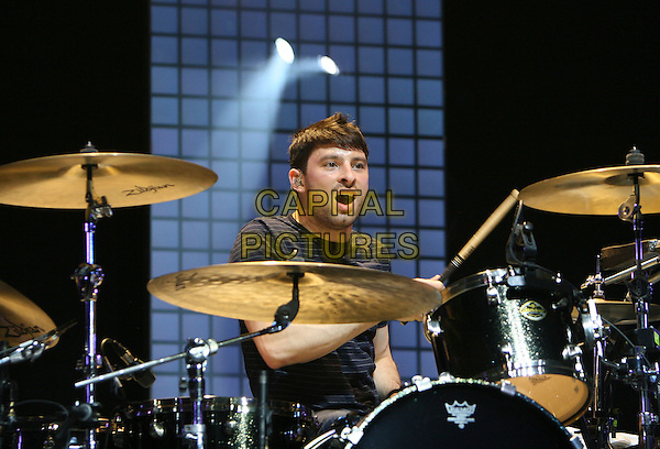 RAZORLIGHT - David 'Skully' Sullivan-Kaplan.Indie rock band Razorlight perform live at the O2 Arena in London, England, UK, May 7th 2009..concert music gig on stage performing drummer drum kit drums playing drumming mouth open funny half length .CAP/MAR.©Martin Harris/Capital Pictures