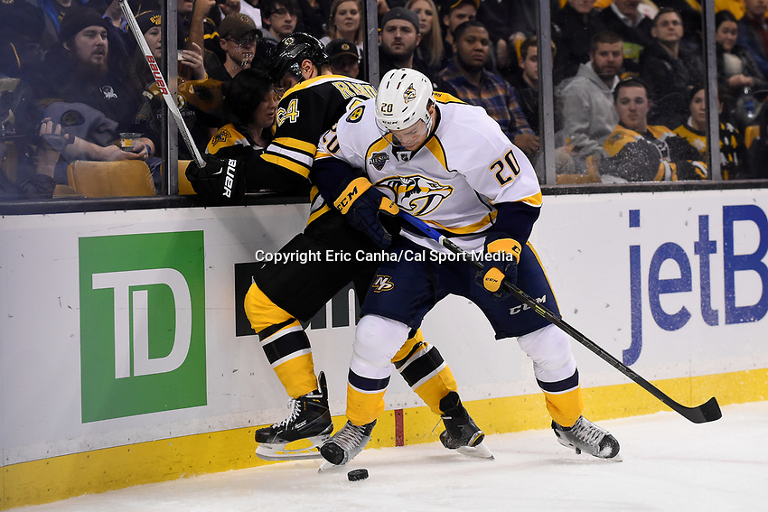 Monday, December 7, 2015: Nashville Predators left wing Miikka Salomaki (20) battles Boston Bruins right wing Tyler Randell (64) for the puck during the National Hockey League game between the Nashville Predators and the Boston Bruins held at TD Garden, in Boston, Massachusetts. The Predators defeat the Bruins 3-2 in regulation time. Eric Canha/CSM