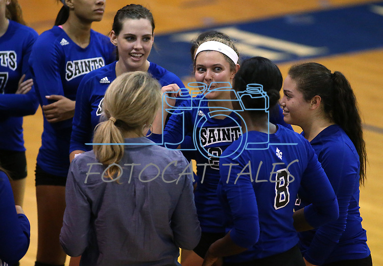 The Marymount Saints talk on the sidelines of a college volleyball game against St. Mary's, in Lexington Park, MD, on Wednesday, Oct. 29, 2014. Marymount won 3-2 to go 24-9 on the season.<br /> Photo by Cathleen Allison