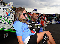 Jul, 22, 2012; Morrison, CO, USA: NHRA top fuel dragster driver Antron Brown celebrates with Megan Fessel Schumacher after winning the Mile High Nationals at Bandimere Speedway. Mandatory Credit: Mark J. Rebilas-