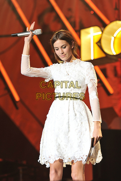 Alexa Chung.Orange Rockcorp Concert, Wembley Arena, London, England..July 12th, 2011.stage concert live gig performance music half length white dress lace microphone arm in air looking down.CAP/MAR.© Martin Harris/Capital Pictures.