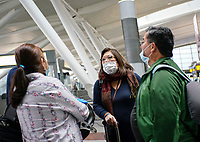 NEW YORK, NEW YORK - MARCH 03 : People wear face masks inside the John F. Kennedy International Airport in New York on March 03, 2020. New York confirms second coronavirus case, as flights cancelations and Jewish schools close over virus fears.The first person to test positive for coronavirus in the state is a 39-year-old health-care worker who arrived from Iran with her husband, the second one is an attorney who lives in Westchester County, works in Manhattan, Gov. Andrew Cuomo said. (Photo by Eduardo Munoz / VIEWpress via Getty Images)
