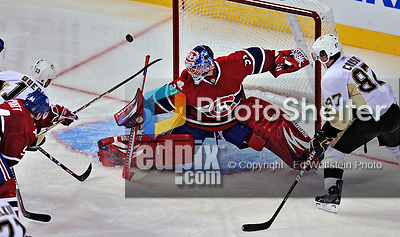 21 September 2009: Montreal Canadiens' goaltender Carey Price makes a stick save in the third period of a pre-season game against the Pittsburgh Penguins at the Bell Centre in Montreal, Quebec, Canada. The Canadiens edged out the defending Stanley Cup Champions 4-3. Mandatory Credit: Ed Wolfstein Photo