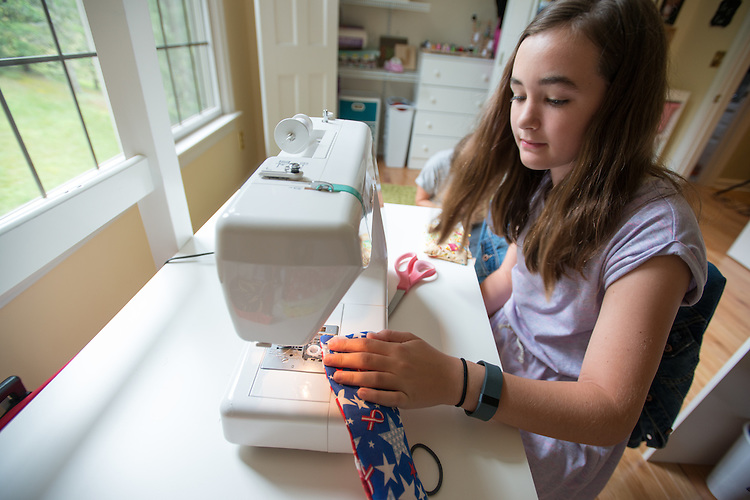"Jordan Phillips, 12, makes Cozys for the Cure with her mother Nicole Phillips at their home in Athens. ""In May of 2015, my mom was diagnosed with breast cancer. The idea for making cozies came from my love of sewing and my love for my mom. I've been sewing for almost six years and when I heard about the Race for the Cure coming to Athens, I knew I wanted to make something to fundraise. Making the cozies is a great way to raise awareness for the cause, and to show my mom that I love and support her.""- Jordan Phillips"