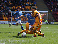 Keith Lasley takes the ball from Alan Maybury in the Motherwell v St Johnstone Clydesdale Bank Scottish Premier League match played at Fir Park, Motherwell on 28.4.12...