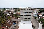 puerto ayora galapagos turns from a small village in a twon that never sleeps. Every day the building activities go on and on. More and more building, higher and higher. These pictures I took all around in the middle of town.