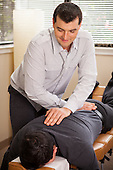 A photo of an Austin, Texas chiropractor working with a patient by Austin photographer Matthew Lemke.