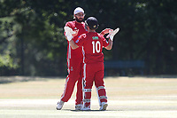 Monty Panesar of Hornchurch celebrates with his team mates after taking the wicket of Hassan Chowdhury during Wanstead and Snaresbrook CC vs Hornchurch CC, Shepherd Neame Essex League Cricket at Overton Drive on 30th June 2018