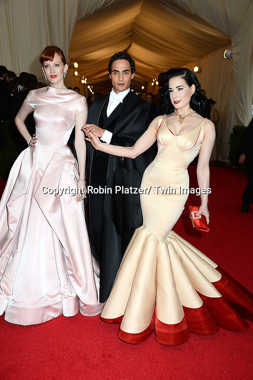 Crystal Renn, Zac Posen and Dita Von Teese attends the Costume Institute Benefit on May 5, 2014 at the Metropolitan Museum of Art in New York City, NY, USA. The gala celebrated the opening of Charles James: Beyond Fashion and the new Anna Wintour Costume Center.