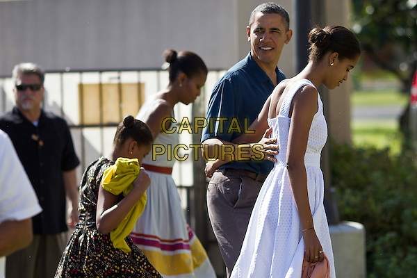 United States President Barack Obama, First Lady Michelle Obama and daughters Malia and Sasha Obama enter the Marine Corps Base Hawaii Chapel to attend Christmas services in Kaneohe, Hawaii, Sunday, December 25, 2011.  Obama is spending the Christmas holiday in his native Hawaii with his family. .CAP/ADM/CNP/Pool/KN.©Kent Nishimura/Pool/CNP/AdMedia/CapitalPictures.