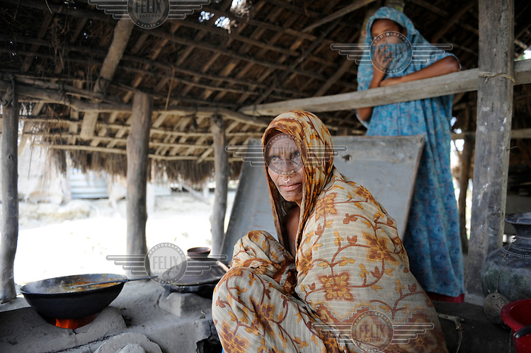 Villagers living on an island in Patuakhali district that was devastated by Cyclone Nargis. The region is known for its annual floods, which prevents necessary investment in the area. As water levels continue to rise, villagers will soon have to find another place to live.